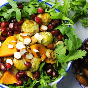 Roasted Brussels sprouts sweet potato salad with crunchy almonds and pomegranates