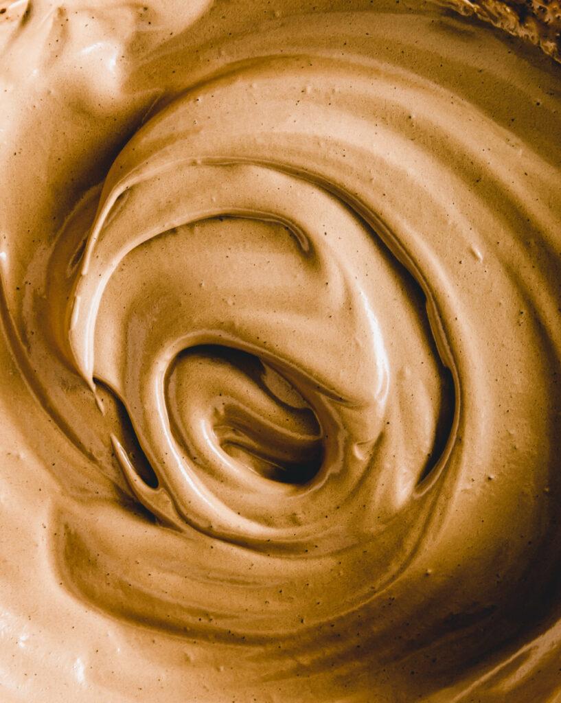 close up brown dalgona foam with a swirl