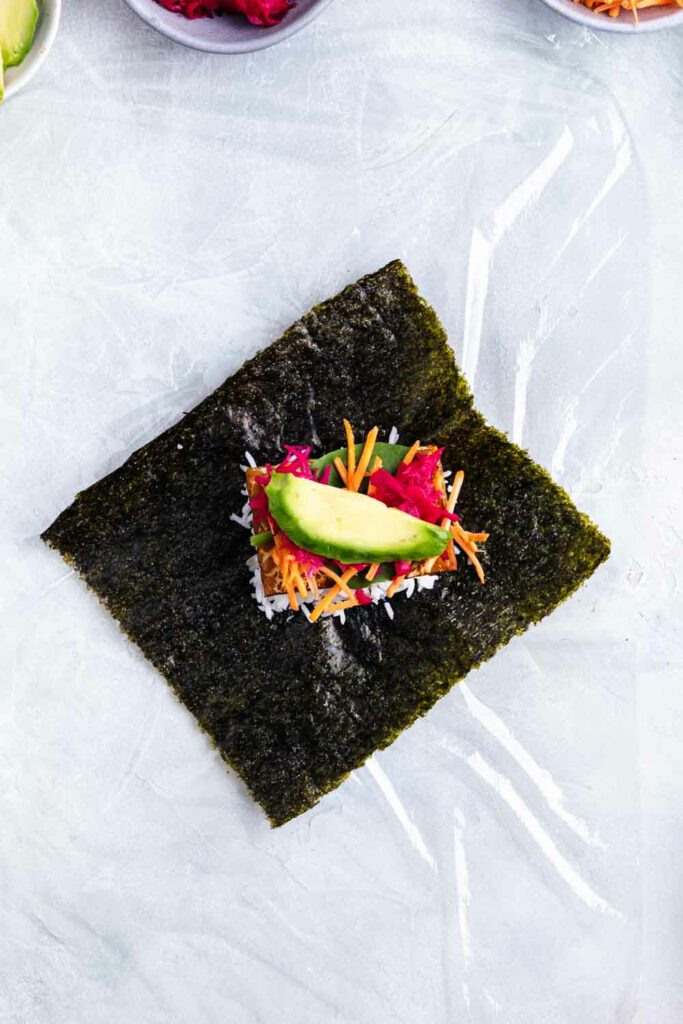 Nori sheet with onigirazu ingredients on it
