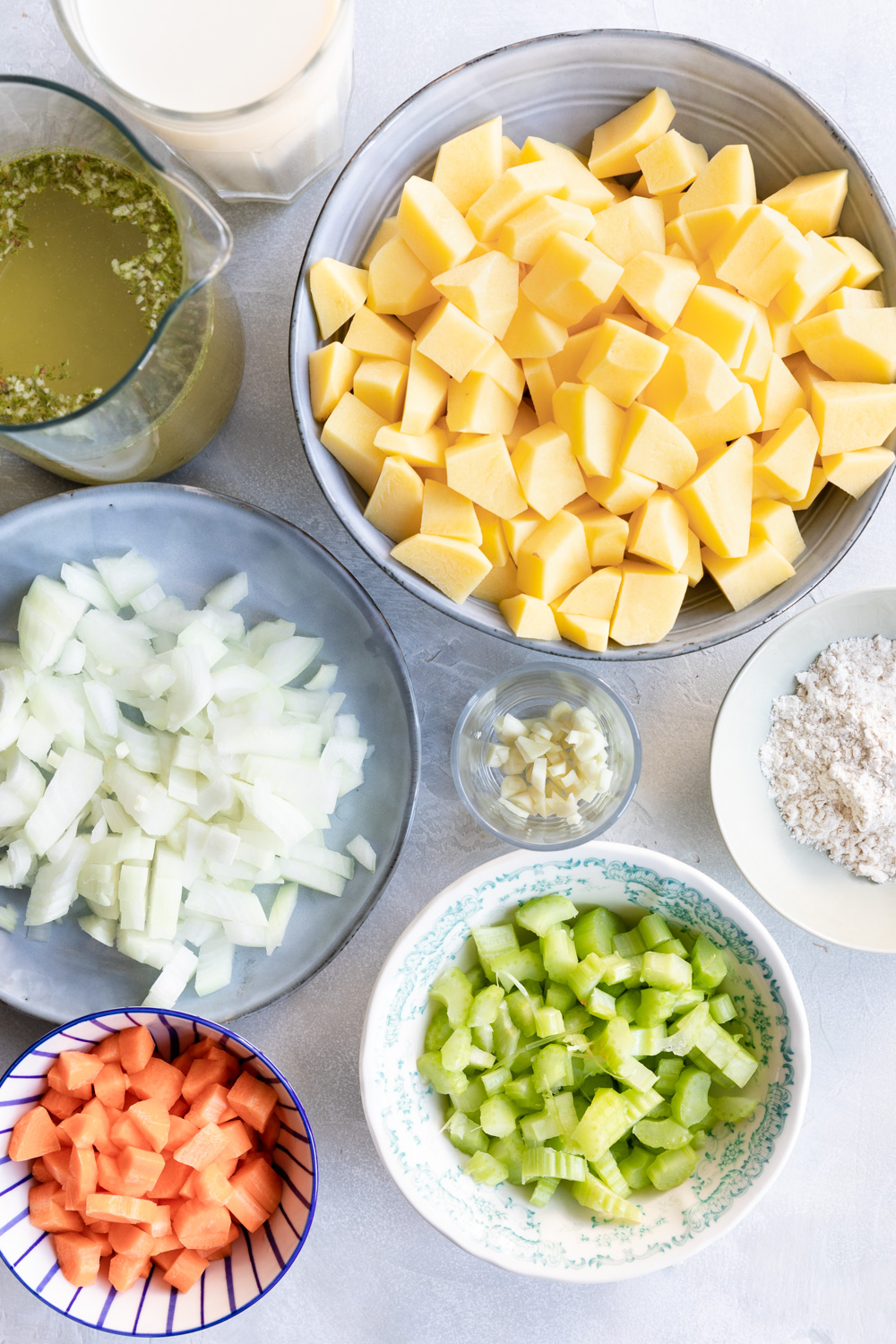 photo of ingredients for potato soup in bowls
