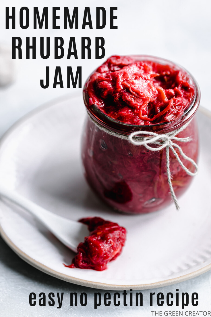 glass jar with red rhubarb jam on a white plate with a white teaspoon with rhubarb jam the teaspoon
