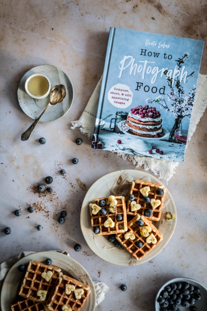 bea lubas photography book on light brown backdrop with plates with waffles