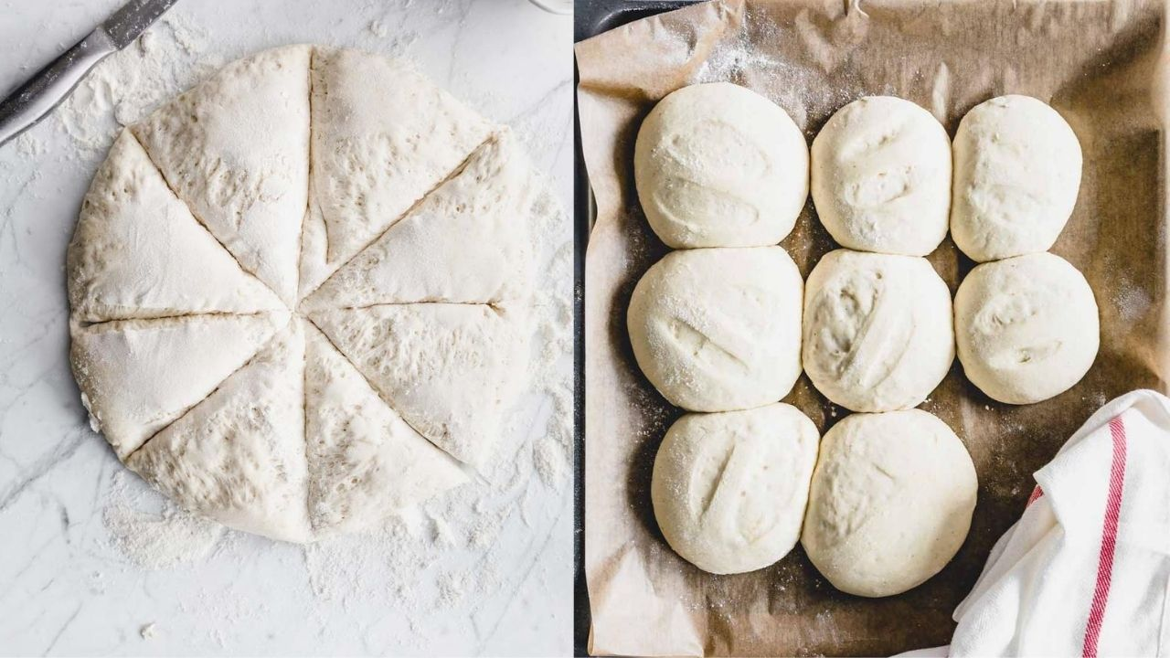 round dinner rolls batter cut in eight parts on a white backdrop with a silver knife next to dinner rolls on a lined baking sheet with parchment paper