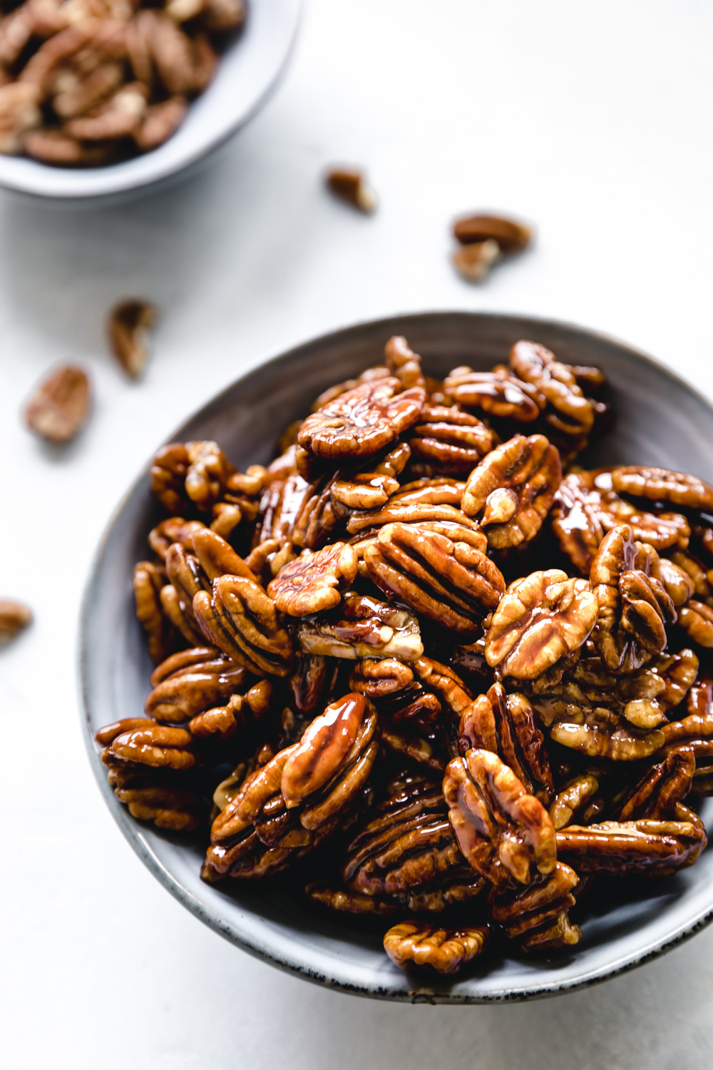 candied pecans in small light blue bowl on marble