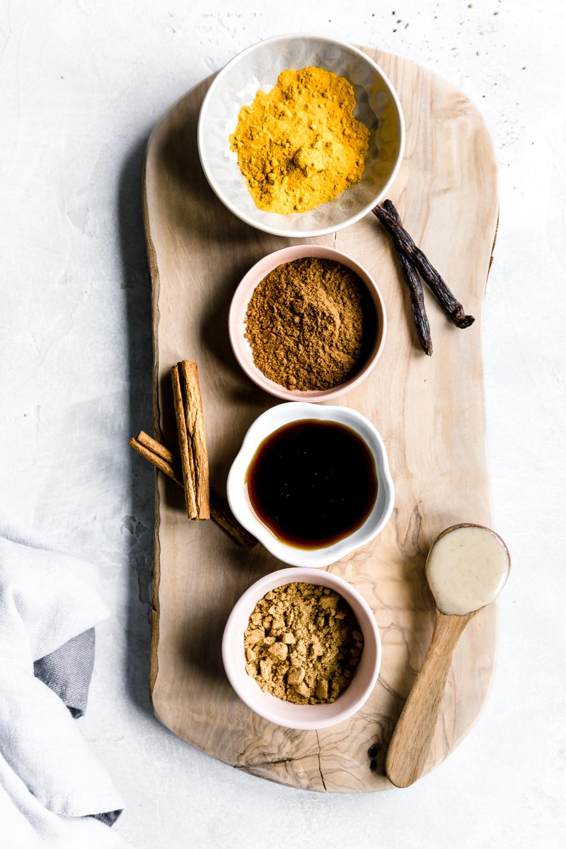 ingredients golden milk on a wooden cutting board