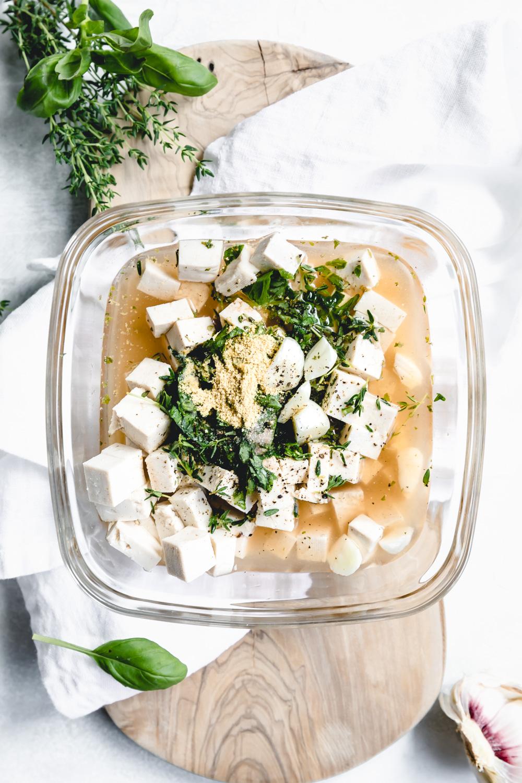 vegan feta cheese ingredients with herbs on a white napkin