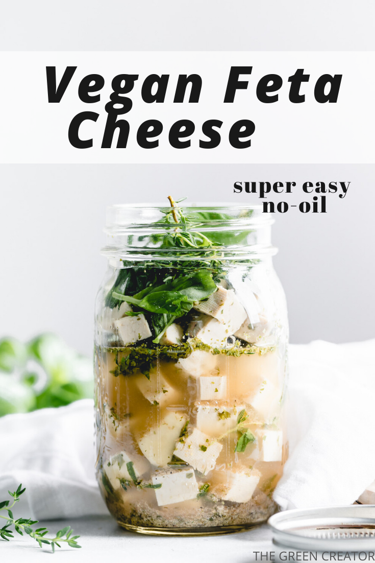 vegan feta cheese in glass jar with herbs on top